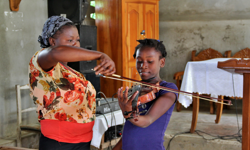 Global Orphan Project_playing violin